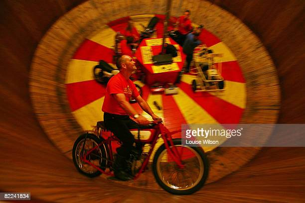 Ken Fox rides the 'Wall of Death' on a 1920's Indian Scout motorcycle at the 'Bulldog Bash' motorcycle festival on August 8 2008 at Long Marston...