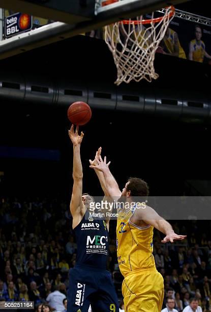 Ken Frease of Braunschweig challenges Elmedin Kikanovic of Alba Berlin during the Bundesliga basketball game between Basketball Loewen Braunschweig...