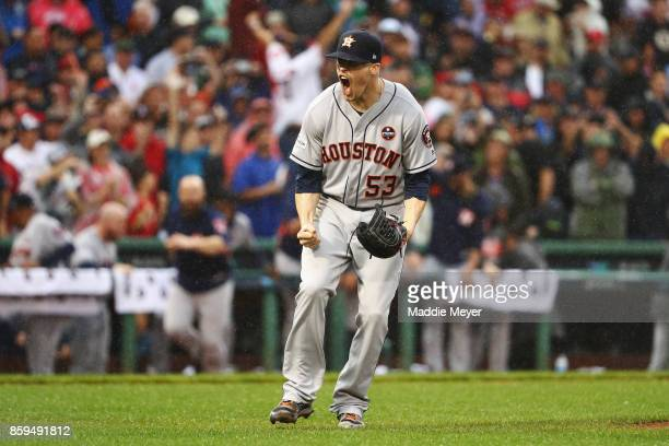 Ken Giles of the Houston Astros celebrates after recording the final out in the ninth inning to defeat the Boston Red Sox 54 in game four of the...