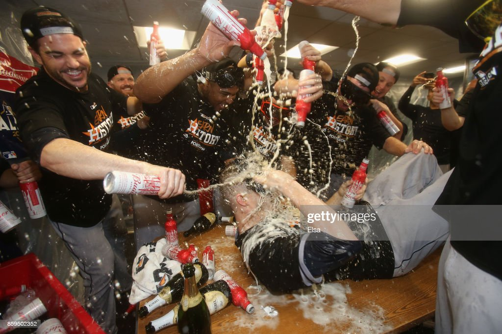 Ken Giles #53 of the Houston Astros (on table) celebrates with teammates in the clubhouse after defeating the Boston Red Sox 5-4 in game four of the American League Division Series at Fenway Park on October 9, 2017 in Boston, Massachusetts. The Astros advance to the American League Championship Series.
