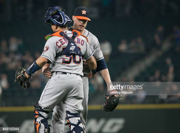 Ken Giles of the Houston Astros is greeted by Juan Centeno after closing out the game against the Seattle Mariners at Safeco Field on September 5...