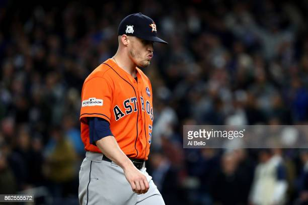 Ken Giles of the Houston Astros walks off the mound as he leaves the game during the eighth inning against the New York Yankees in Game Four of the...