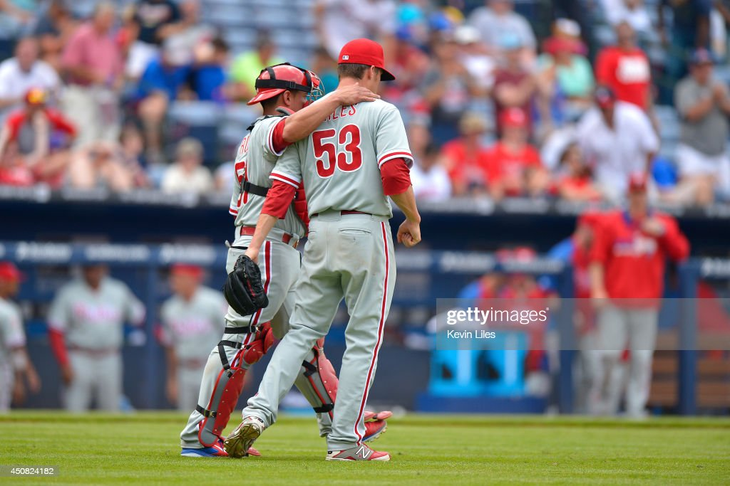 Ken Giles of the Philadelphia Phillies celebrates with Pedro Beato of the Atlanta Braves after defeating the Atlanta Braves 105 at Turner Field on...