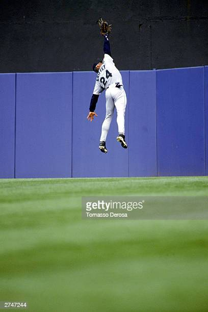 Ken Griffey Jr #24 of the Seattle Mariners jumps to make a catch during the American League game against the New York Yankees at Yankee Stadium on...