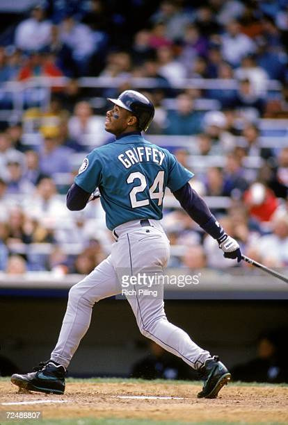 Ken Griffey Jr #24 of the Seattle Mariners watches the flight of the ball as he follows through on his swing during a 1994 MLB season game Ken...