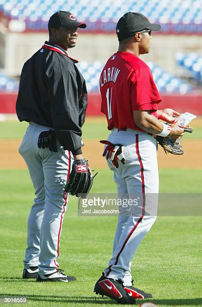 Ken Griffey Jr #30 and Barry Larkin of the Cincinnati Reds warm up during a workout at their spring training facility on February 26 2004 in Sarasota...
