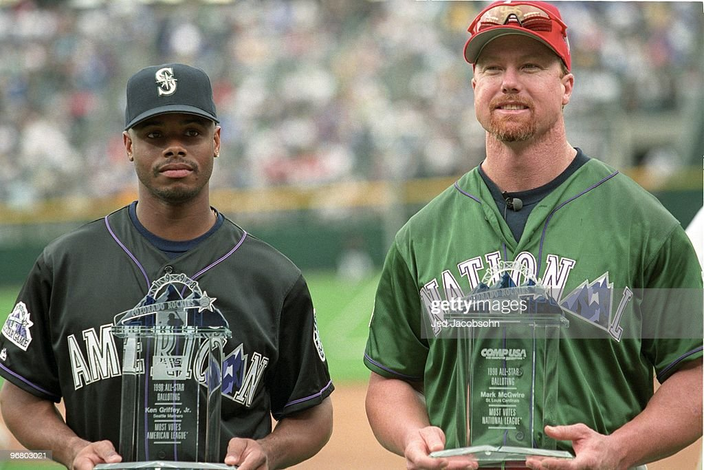 Ken Griffey Jr. and Mark McGwire display trophies for getting the most votes in all-star balloting prior to the 69th MLB All-Star Game at Coors Field on July 6, 1998 in Denver, Colorado.