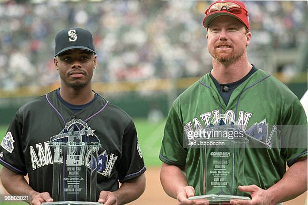 Ken Griffey Jr and Mark McGwire display trophies for getting the most votes in allstar balloting prior to the 69th MLB AllStar Game at Coors Field on...