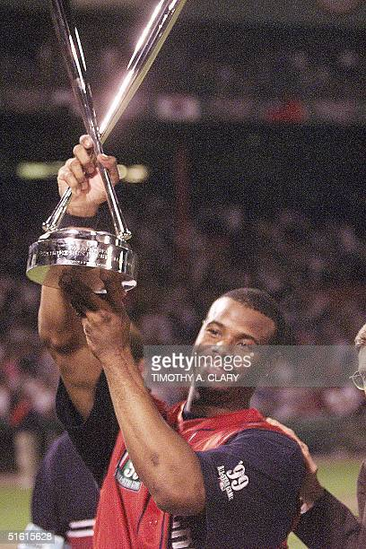 Ken Griffey Jr of the Seattle Mariners holds his trophy after winning the HomeRun derby during the 70th AllStar Game Weekend at Fenway Park 12 July...
