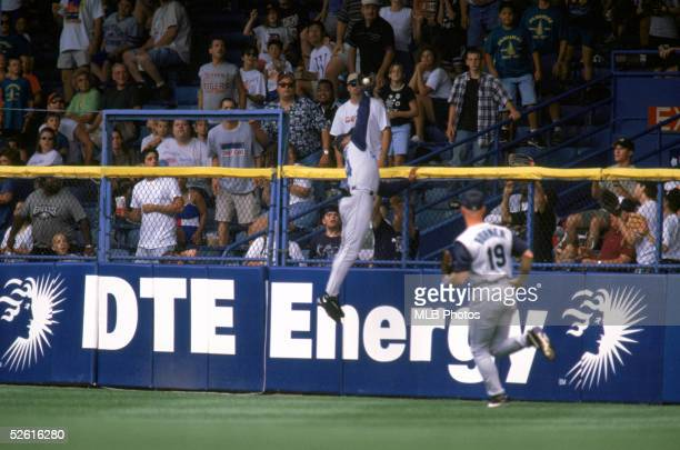 Ken Griffey Jr of the Seattle Mariners jumps and robs a home run during the season game at Tiger Stadium in Detroit Michigan on August 9 1998 Ken...