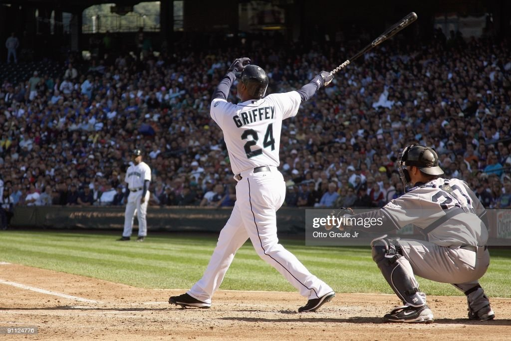 Ken Griffey Jr #24 of the Seattle Mariners makes a hit during the game against the New York Yankees on September 20, 2009 at Safeco Field in Seattle, Washington.