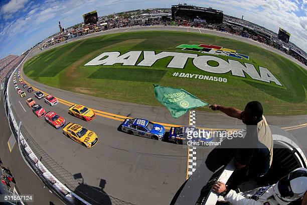 Ken Griffey Jr waves the green flag as Chase Elliott driver of the NAPA Auto Parts Chevrolet leads the field to start the NASCAR Sprint Cup Series...