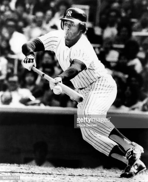 Ken Griffey Sr #33 of the New York Yankees bunts during an MLB game circa 1983 at Yankee Stadium in the Bronx New York