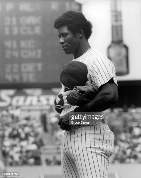 Ken Griffey Sr # 33 of the New York Yankees holds his hat over his heart during the National Anthem before an MLB game circa 1983 at Yankee Stadium...