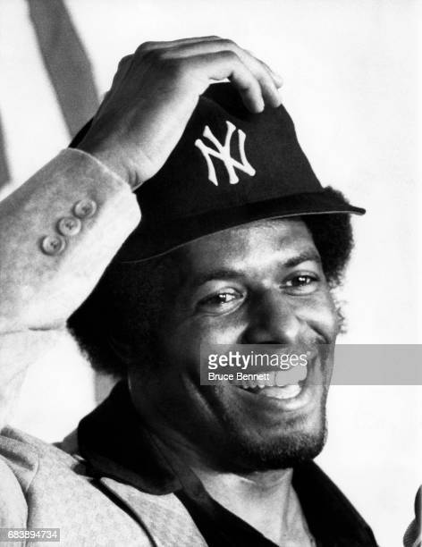 Ken Griffey Sr #6 of the New York Yankees smiles as he tries on his new hat after being traded by the Cincinnati Reds on November 4 1981 at Yankee...