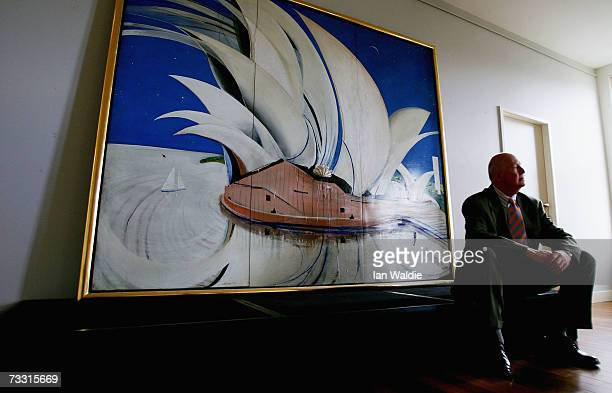 Ken Groves general manager of Qantas Corporate Affairs sits near artist Brett Whiteley's work 'Opera House' during the painting's unveiling February...