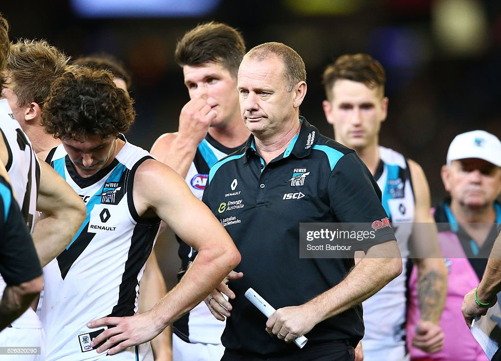 Ken Hinkley, coach of the Power speaks to his team during a quarter time break during the round six AFL match between the Richmond Tigers and the Port Adelaide Power at Melbourne Cricket Ground on April 30, 2016 in Melbourne, Australia.
