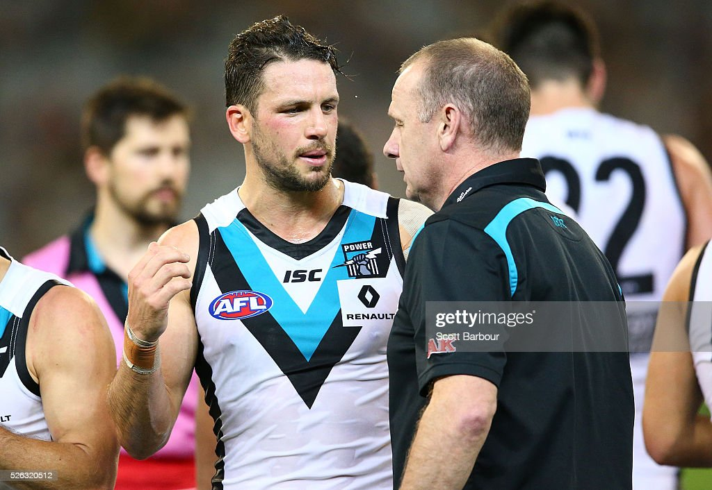 Ken Hinkley, coach of the Power speaks with Travis Boak of the Power during a quarter time break during the round six AFL match between the Richmond Tigers and the Port Adelaide Power at Melbourne Cricket Ground on April 30, 2016 in Melbourne, Australia.