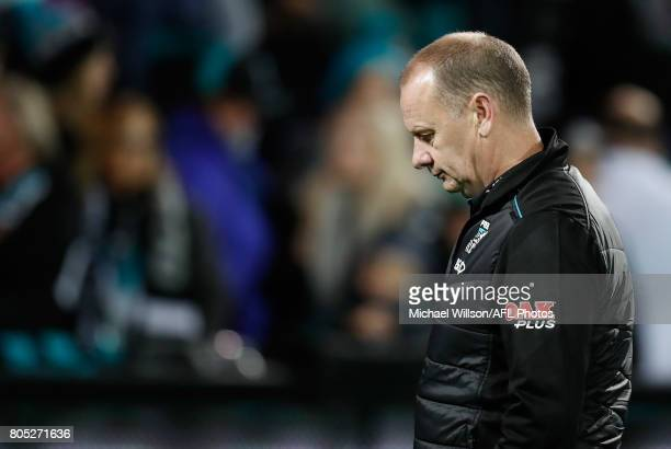 Ken Hinkley Senior Coach of the Power looks dejected after a loss during the 2017 AFL round 15 match between the Port Adelaide Power and the Richmond...