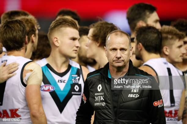 Ken Hinkley Senior Coach of the Power looks on during the 2017 AFL round 12 match between the Essendon Bombers and the Port Adelaide Power at Etihad...