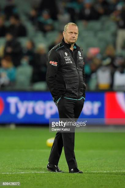 Ken Hinkley the coach of the Power looks on prior to the round 23 AFL match between the Port Adelaide Power and the Gold Coast Suns at Adelaide Oval...