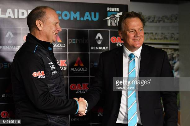 Ken Hinkley the coach of the Power shakes hands with Port Adelaide chief executive Keith Thomas at Alberton Oval on September 19 2017 in Adelaide...