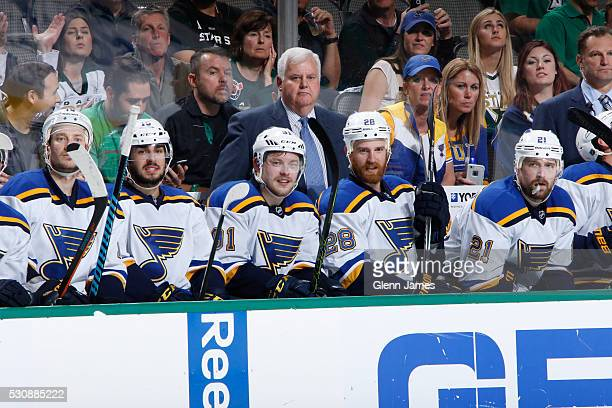 Ken Hitchcock and the St Louis Blues watch the action from the bench against the Dallas Stars in Game Seven of the Western Conference Second Round...