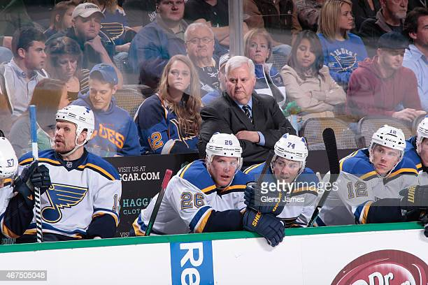 Ken Hitchcock head coach of the St Louis Blues watches the action from behind the bench against the Dallas Stars at the American Airlines Center on...