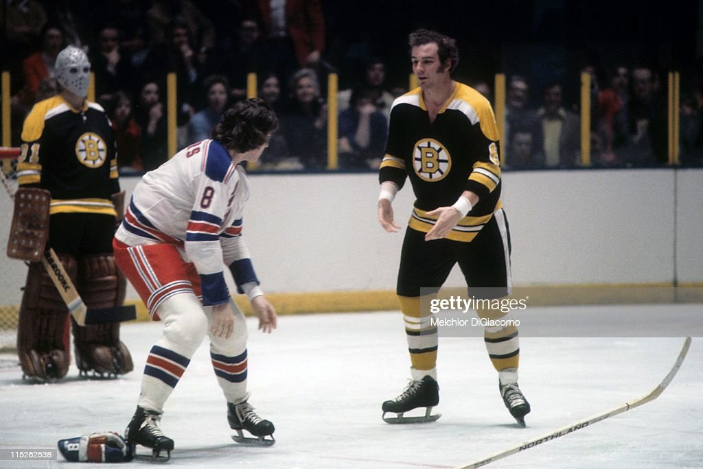 Ken Hodge #8 of the Boston Bruins drops the gloves to fight Steve Vickers #8 of the New York Rangers circa 1973 at the Madison Square Garden in New York, New York. Goalie <a gi-track='captionPersonalityLinkClicked' href=/galleries/search?phrase=Jacques+Plante&family=editorial&specificpeople=227203 ng-click='$event.stopPropagation()'>Jacques Plante</a> #31 of the Bruins looks on.