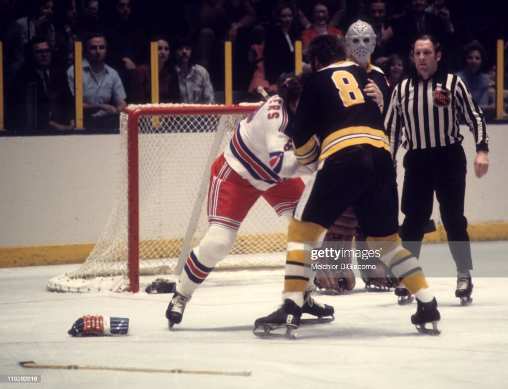 Ken Hodge #8 of the Boston Bruins fights with Steve Vickers #8 of the New York Rangers during their game circa 1973 at the Madison Square Garden in New York, New York. Goalie <a gi-track='captionPersonalityLinkClicked' href=/galleries/search?phrase=Jacques+Plante&family=editorial&specificpeople=227203 ng-click='$event.stopPropagation()'>Jacques Plante</a> #31 looks on.
