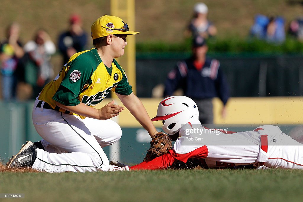 Ken Igeta # 6 of the Japan team from Hamamatsu City, Japan is tagged out by third baseman Dylan Palmer #13 of the West team from Huntington Beach, California trying to advance to third base during the sixth inning of the Little League World Series championship game on August 28, 2011 in South Williamsport, Pennsylvania. The West team defeated the team from Japan 2-1.