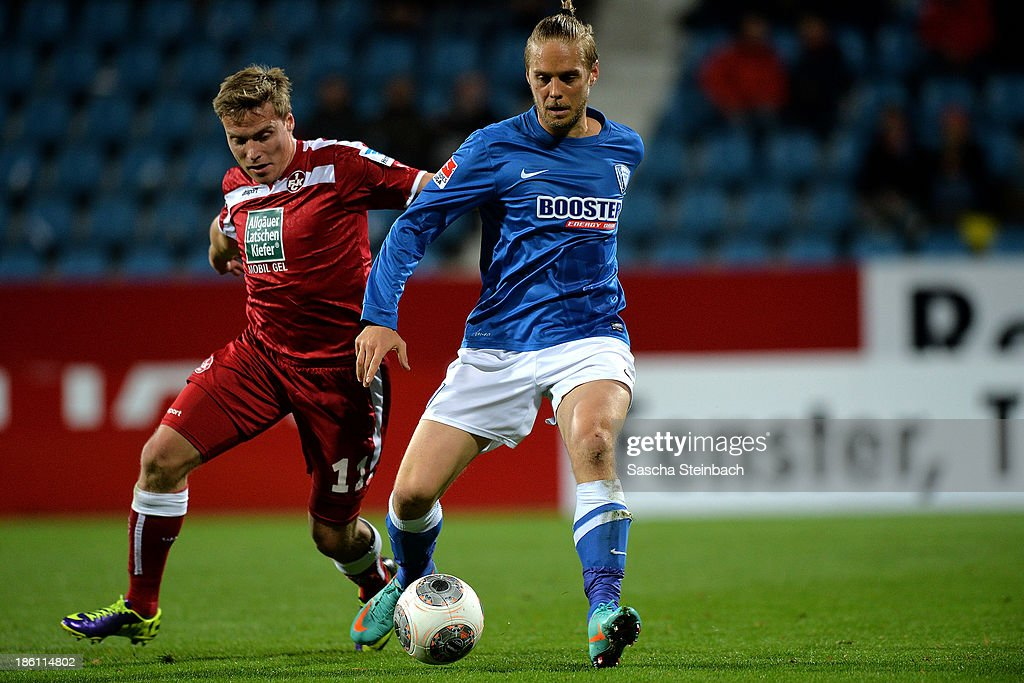 Ken Ilsoe (R) of Bochum is challenged by Ruben Jenssen (L) of Kaiserslautern during the Second Bundesliga match between VfL Bochum and 1. FC Kaiserslautern at Rewirpower Stadion on October 28, 2013 in Bochum, Germany.