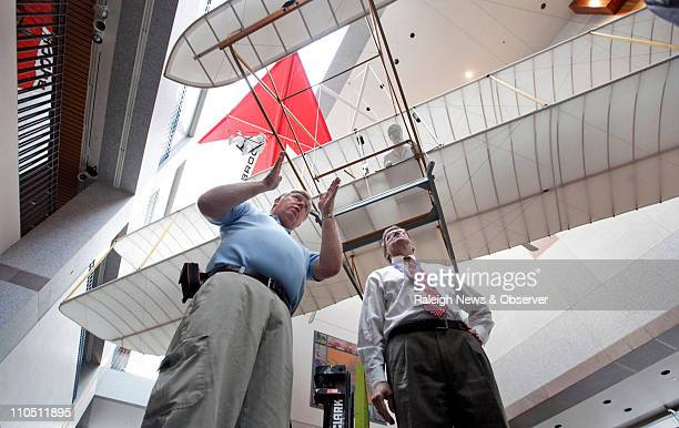 Ken Kellett left builder of the fullscale reproduction 1903 Wright Flyer explains the plan for moving it to William McCrea Monday March 21 2011 The...