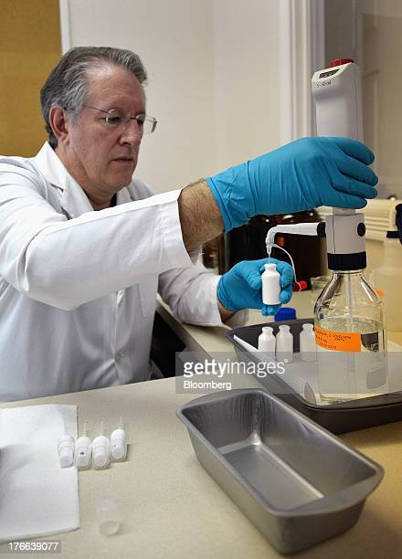 Ken Kirby president of Transdermal Delivery Solutions uses a calibrated dispenser to fill tester spray bottles of progesterone in Palm Beach Gardens...