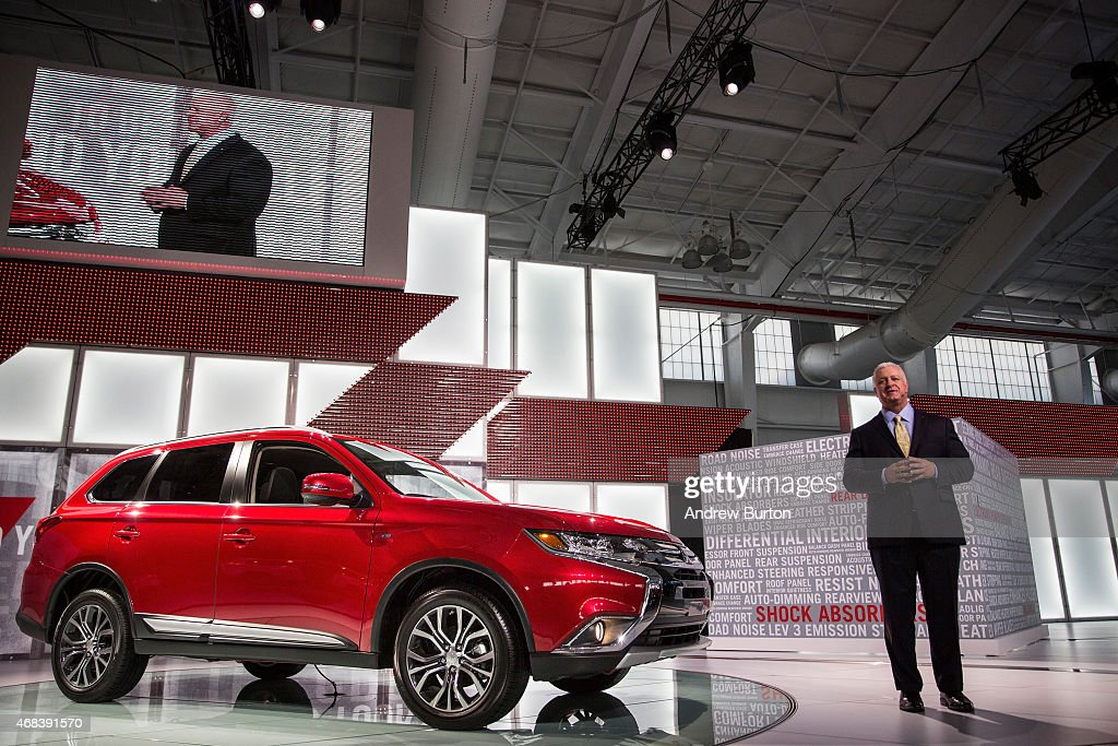 Ken Koneicaka Mitsubishi Motors Vice President of sales introduces the 2016 Nissan Maxima at the New York International Auto Show on April 2 2015 in...
