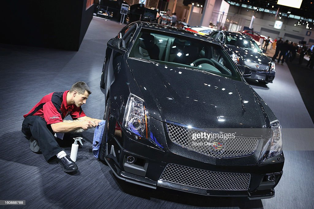 Ken Kozlowski details a Cadillac CTS at the Chicago Auto Show on February 7, 2013 in Chicago, Illinois. The Chicago Auto Show, one of the oldest and largest in the country, will be open to the public February 9-18.
