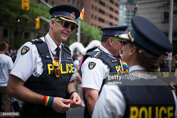 Ken Leppert of the Ontario Provincial Police speaks with colleagues at the annual Pride Festival parade July 3 2016 in Toronto Ontario Canada Prime...