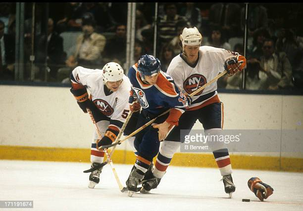 Ken Linesman of the Edmonton Oilers goes for the puck as Mike Bossy and Denis Potvin of the New York Islanders defend during the 1984 Stanley Cup...