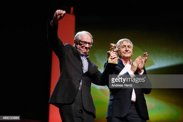 Ken Loach receives his Honoray Golden Bear next to director Jiri Menzel during the 64th Berlinale International Film Festival at Berlinale Palast on...