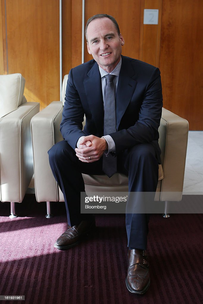 Ken MacKenzie, chief executive officer of Amcor Ltd., sits for a photograph in Sydney, Australia, on Monday, Feb. 18, 2013. Amcor expects to deliver higher underlying profit in the current year. Photographer: Brendon Thorne/Bloomberg via Getty Images