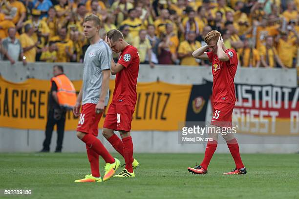 Ken Martin Gipson Benno Schmitz and Zsolt Kalmar of Leipzig are seen after the DFB Cup match between Dynamo Dresden and RB Leipzig at DDVStadion on...