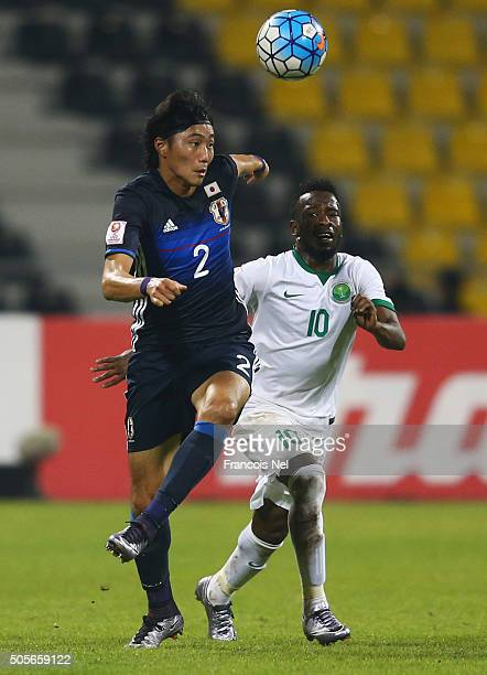 Ken Matsubara of Japan beats Fhad Almuwallad of Saudi Arabia to the ball during the AFC U23 Championship Group B match between Saudi Arabia and Japan...