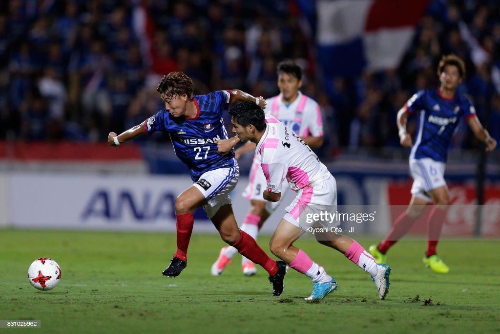 Ken Matsubara of Yokohama F.Marinos controls the ball under pressure of Riki Harakawa of Sagan Tosu during the J.League J1 match between Yokohama F.Marinos and Sagan Tosu at Nippatsu Mitsuzawa Stadium on August 13, 2017 in Yokohama, Kanagawa, Japan.