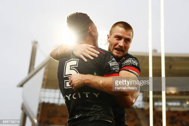 Ken Maumalo celebrates with Kieran Foran of the Warriors after scoring a try during the round 25 NRL match between the New Zealand Warriors and the...
