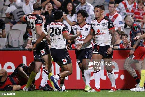 Ken Maumalo of the Warriors celebrates with his team mates after scoring a try during the round four NRL match between the St George Illawarra...
