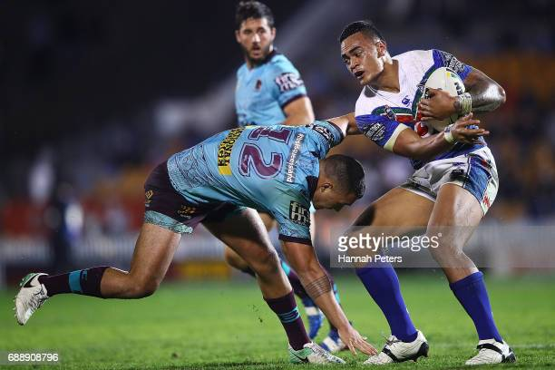 Ken Maumalo of the Warriors fends off Jaydn Su'A of the Broncos during the round 12 NRL match between the New Zealand Warriors and the Brisbane...
