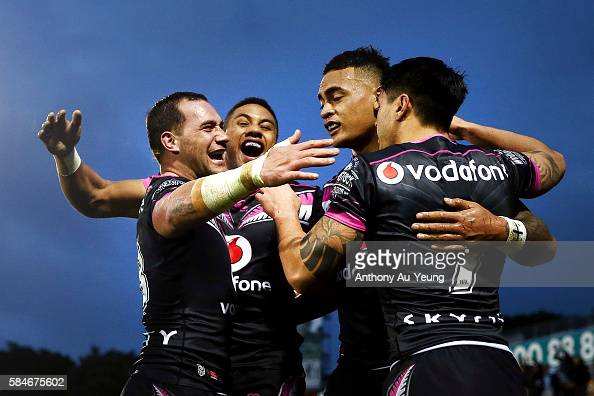 Ken Maumalo of the Warriors is congratulated by teammates Bodene Thompson David Fusitu'a and Shaun Johnson after scoring a try during the round 21...
