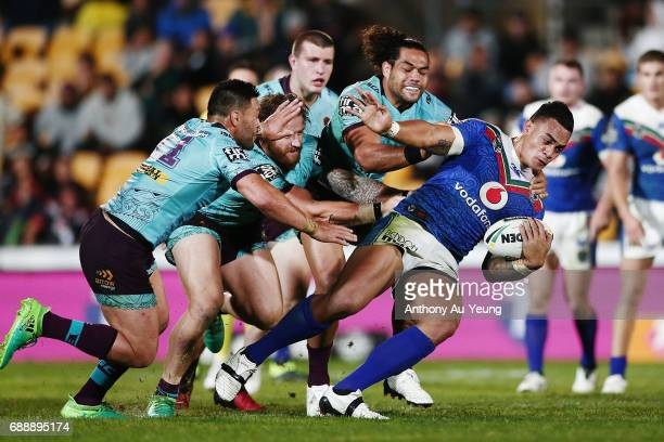 Ken Maumalo of the Warriors is tackled during the round 12 NRL match between the New Zealand Warriors and the Brisbane Broncos at Mt Smart Stadium on...