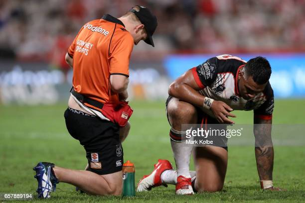 Ken Maumalo of the Warriors receives attention during the round four NRL match between the St George Illawarra Dragons and the New Zealand Warriors...