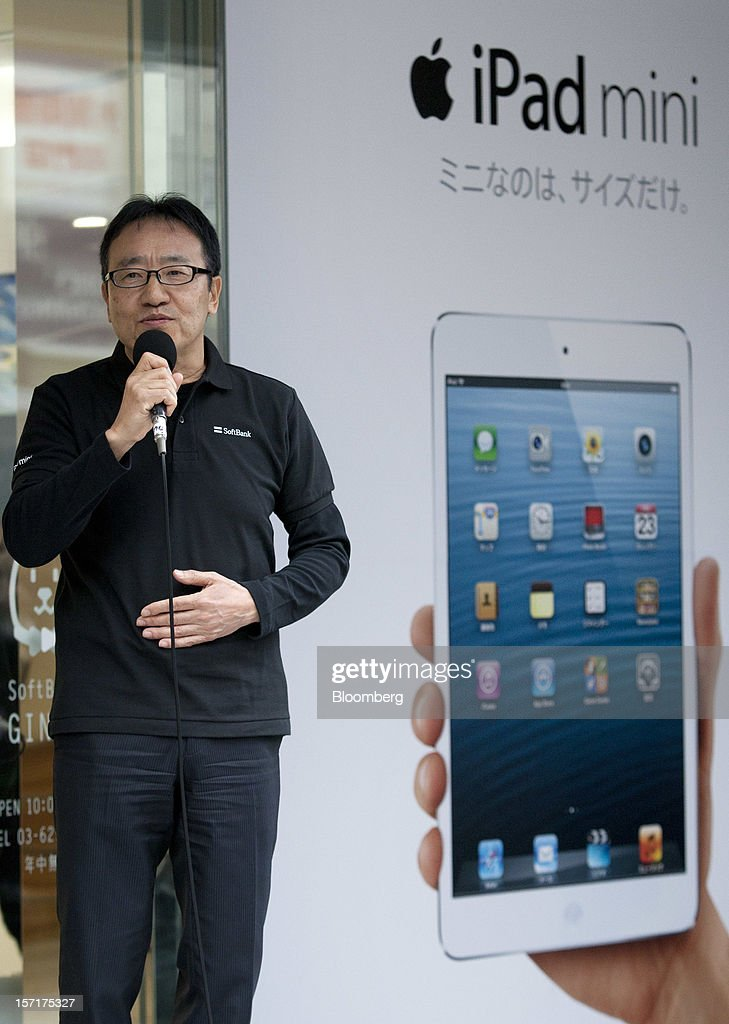 Ken Miyauchi, vice president and chief operating officer of Softbank Corp., speaks during a ceremony as the Apple Inc. iPad Mini goes on sale at the Softbank store in the Ginza district of Tokyo, Japan, on Friday, Nov. 30, 2012. Softbank, the Japanese mobile-phone carrier that agreed this month to buy a $20 billion stake in Sprint Nextel Corp., started to sell the iPad Mini today. Photographer: Tomohiro Ohsumi/Bloomberg via Getty Images